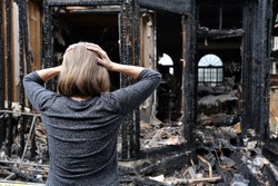 A woman is upset about her house which has burned down.