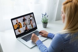 A woman is Working remotely using video conferencing and meetings and work remotely from home, successful work
