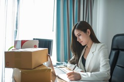 A woman is Working remotely using video conferencing and meetings and work remotely from home using VPN to remote control information from the headquarters, used for successful work