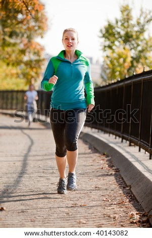 A woman jogging in a park