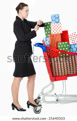 A woman late for something whilst in a shopping scenario with a shopping cart.
