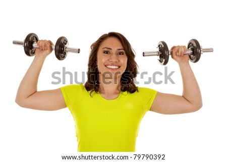 A woman lifting her weights with a huge smile on her face.