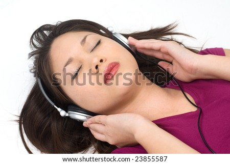 A woman listens to music with her high technology headphones.