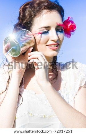 A Woman Listens To The Voice Of Her Creative Imagination While Holding Up A Home Made Tin Phone In A Idea Image Representing Inspiration And Creativity