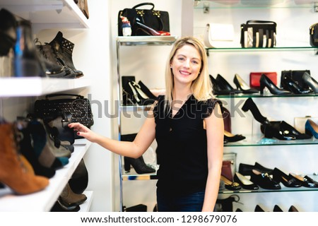 ba3bccba96e Beautiful young woman choosing shoes at the store Images and Stock ...