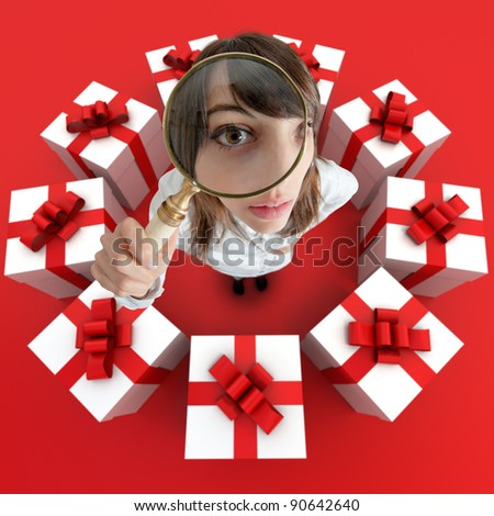A woman looking through a magnifying lens surrounded by presents