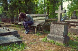 A woman mourns in the cemetery