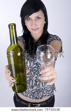 A woman offers a glass of wine