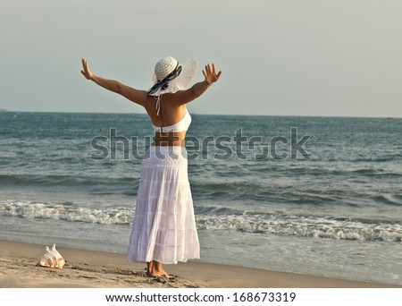 A woman on a background of a sea landscape