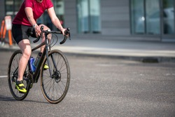 A woman on bicycle and cycling rides are great tools for improving health of the muscles of the hip belt reducing weight and improving female libido improving psychological stability in lifestyle