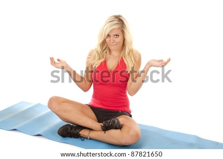 A woman on her yoga mat with a confused expression on her face.
