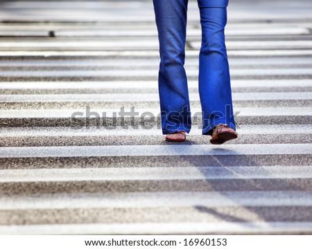 A woman on pedestrian crossing