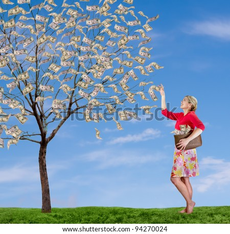 a woman picking money off of a money tree,  with a blue sky and grass.