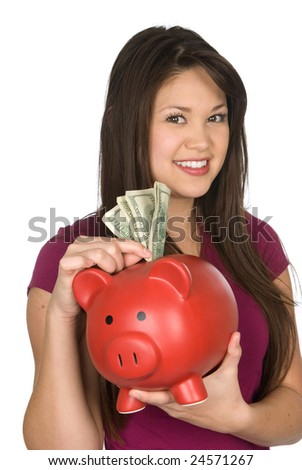 A woman places money into a piggy bank. Excellent for use on any financial and savings reference.