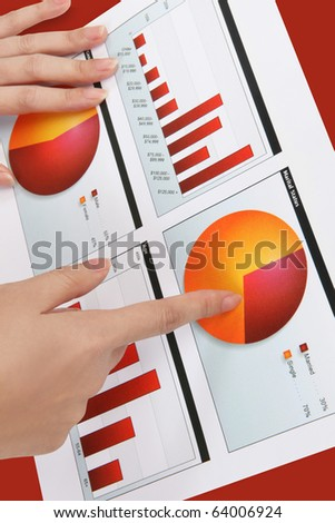 A woman pointing at a colorful chart graph