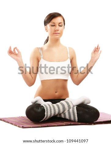 A woman practising yoga, isolated on white background