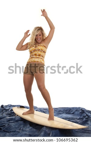 A woman pretending to be surfing on her blue water with an excited expression on her face.