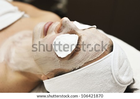 a woman relaxes during a beauty treatment