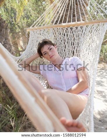 A woman relaxing in a hammock