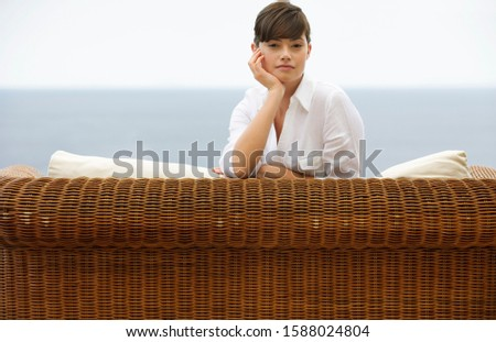 A woman relaxing on a sofa