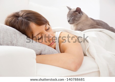 A woman resting in bedroom/ Portrait of a young woman sleeping on the bed