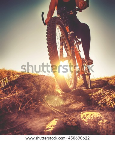 a woman riding a bicycle down a ...