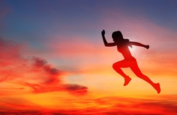 A Woman runner in silhouette on color sky background. Dynamic movement. Side view