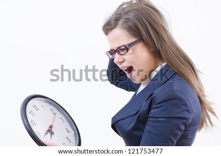 A woman running and holding a clock