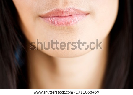 A woman's chin, close-up of lips and chin