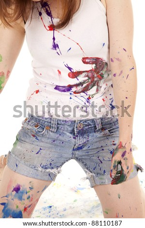 A woman's clothes covered in paint her body is covered too.