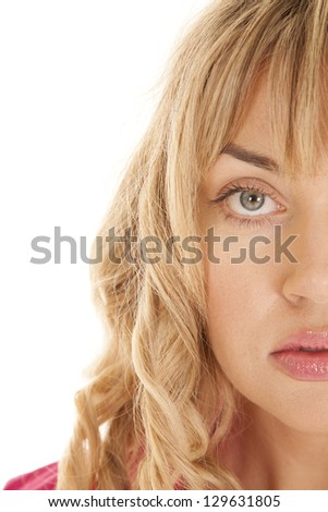 a woman's half face close up.