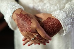 A woman's hand decorated with henna. Makeup beautifies certain body parts usually in order to welcome sacred moments