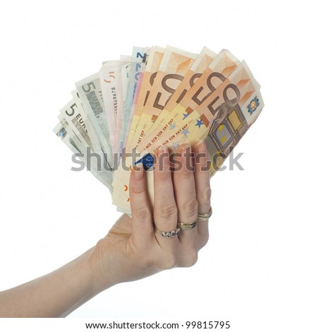 a woman's hand holding several banknotes - stock photo
