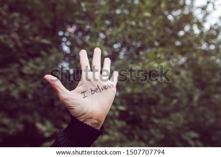 A Woman's hand raised with I believe written in marker on her palm,  supporting victims of abuse