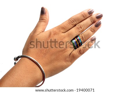A woman 39 s hand wearing multi colored rings bands in a Which finger to wear ring for single