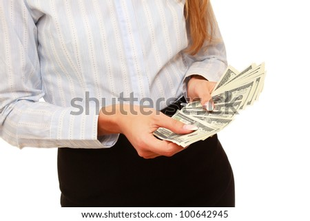 A woman's hands are counting dollars on white
