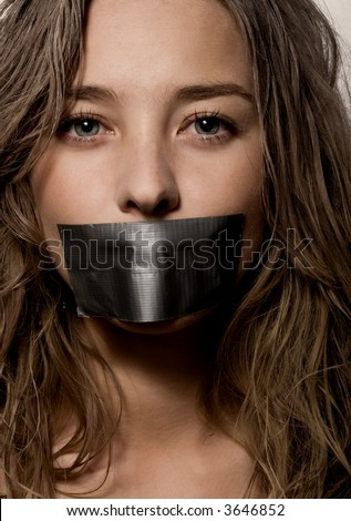 a woman's mouth sealed with a 	 scotch tape
