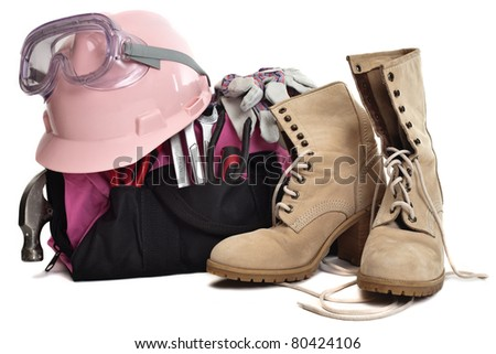 a woman's tool bag.  tools, hard hat, goggles and boots.  A pink tool bag and pink hard hat.