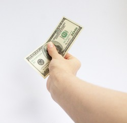 a woman's white hand holds out a dollar bill on a white background