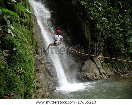 A woman scaling a challenging and dangerous falls. It's not me here but I came before her.