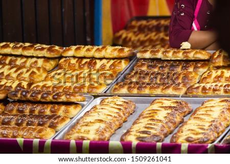 a woman selling traditional pan de fiesta, handmade mexican sweet bread #1509261041