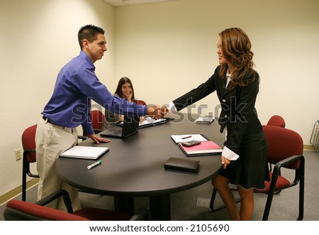 A woman shaking a mans hand to conclude a business deal
