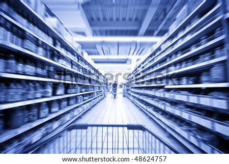 A woman shopping at the supermarket - stock photo