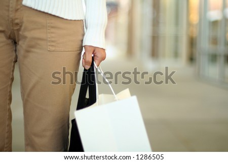 A woman shopping, carrying a bag