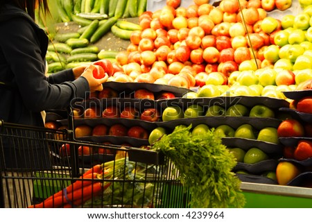 A woman shopping for apples at a grocery store or supermarket