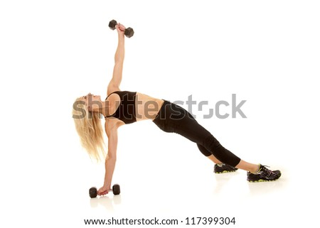 A woman showing her strength by lifting weights.
