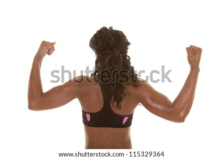 A woman showing off her back muscles by flexing.