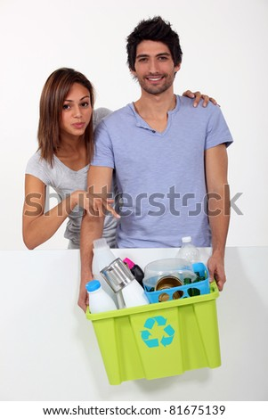 a woman showing ready to recycle materials