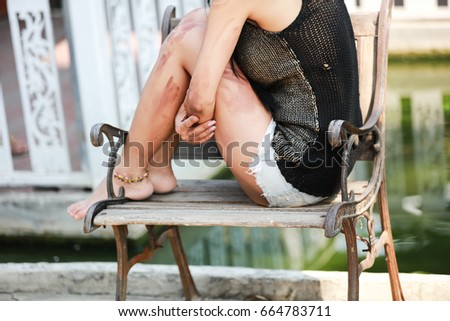 A woman sits and hugs his knees express lonely feeling, sit shadow on desk #664783711