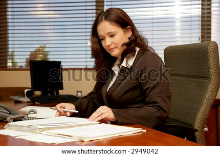 A woman sitting at her desk in a office